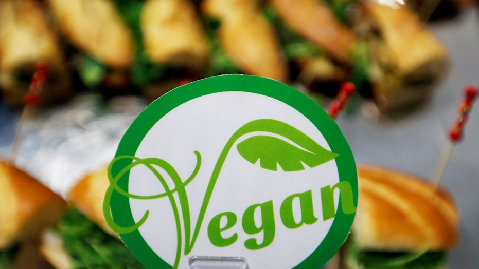 File 2017: A sticker with the word vegan is seen near sandwiches in Toulouse, France. A British chef is receiving backlash after claiming to have put additional non-essential ingredients to a vegan diner's dish on Saturday night.