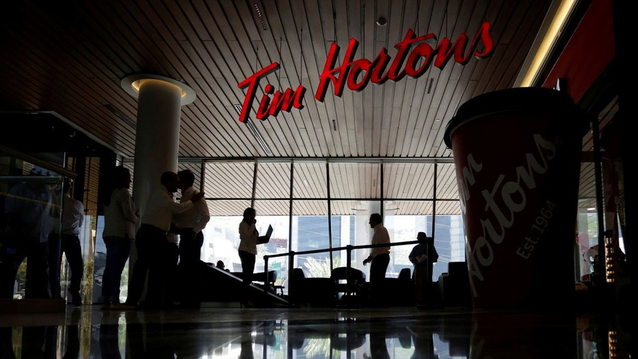 FILE 2017: The Toronto Star reported Wednesday that employees at some of the Canadian-based coffee chain's stores received a letter about benefit changes over the country's new minimum wage increase.