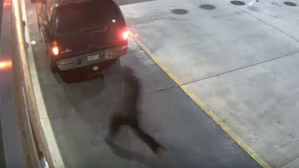 Caught on camera: Armed robber climbs through drive-thru window