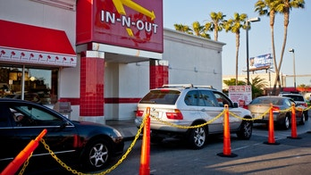 Los Angeles, USA - May 13, 2013: In-n-out Burger, fast food restaurant at Los Angeles Airport. Many cars are waiting in line to be served  in drive-through part of restaurant.