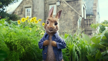 """This image released by Columbia Pictures shows Peter Rabbit, voiced by James Corden and Cottontail in a scene from """"Peter Rabbit."""" (Columbia Pictures/Sony via AP)"""
