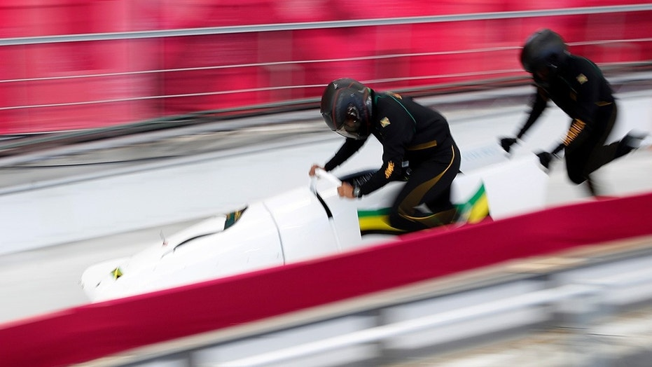 Jazmine Fenlator-Victorian and Carrie Russell of Jamaica in action at the 2018 Winter Games.