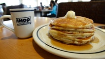 A stack of pancakes are pictured at an IHOP restaurant in Los Angeles August 2, 2011. DineEquity Inc reported a lower-than-expected quarterly profit on Tuesday, hurt by weak sales at its IHOP restaurant chain, and its shares plummeted 14 percent. REUTERS/Mario Anzuoni (UNITED STATES - Tags: BUSINESS FOOD) - GM1E7830E2J01