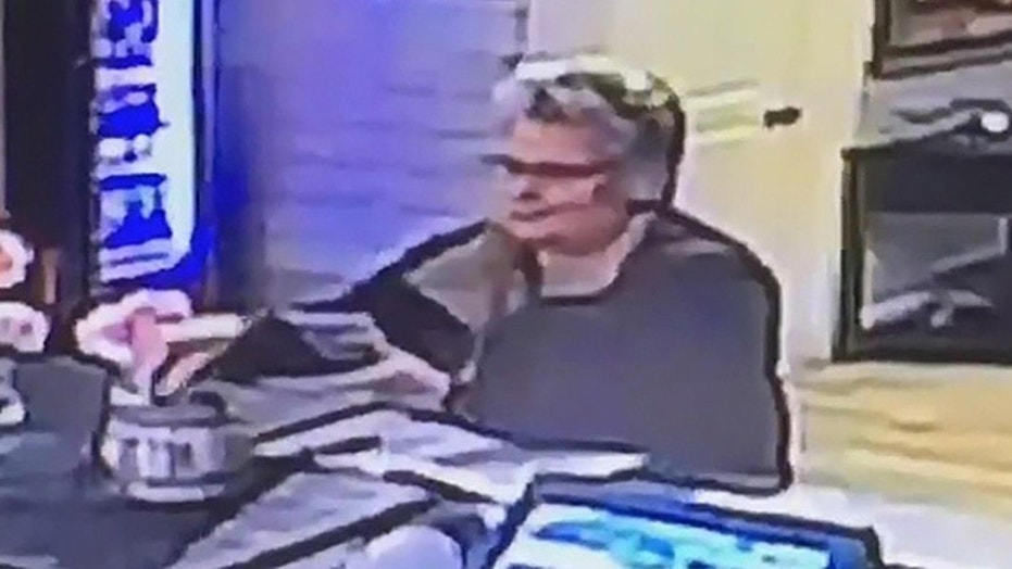 The police are looking for a woman accused of stealing about $20 from a tip jar at a Massachusetts seafood restaurant.