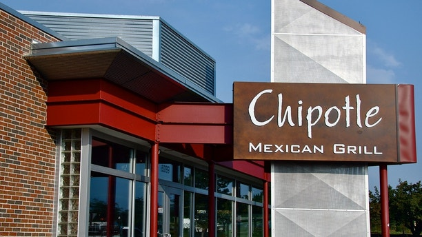 """Falls Church, VA, USA - August 19, 2011:  Chipotle Mexican Grill sign.  Chipotle Mexican Grill, Inc. (NYSE: CMG) is a popular American chain of over 1000 restaurants specializing in burritos and tacos.  The name """"Chipotle"""" comes from the Mexican word for a smoked, dried jalapeAo chili pepper."""