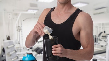 Weight gain. Man put whey protein with amino acids bodybuilding dietary supplement in shaker. Fitness, muscle recovery and sport concept.