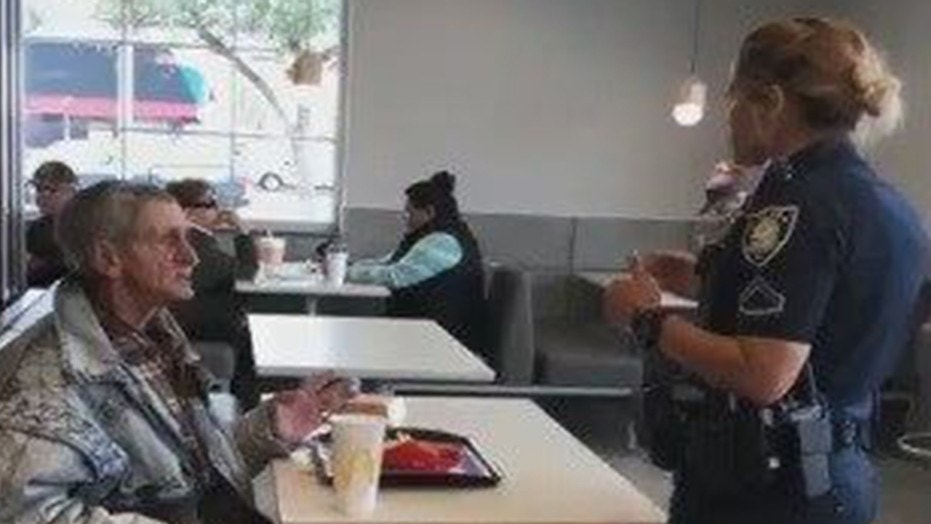 An outraged customer recorded a police officer telling a homeless man to leave McDonald's after paying for his food, inciting outrage on social media.