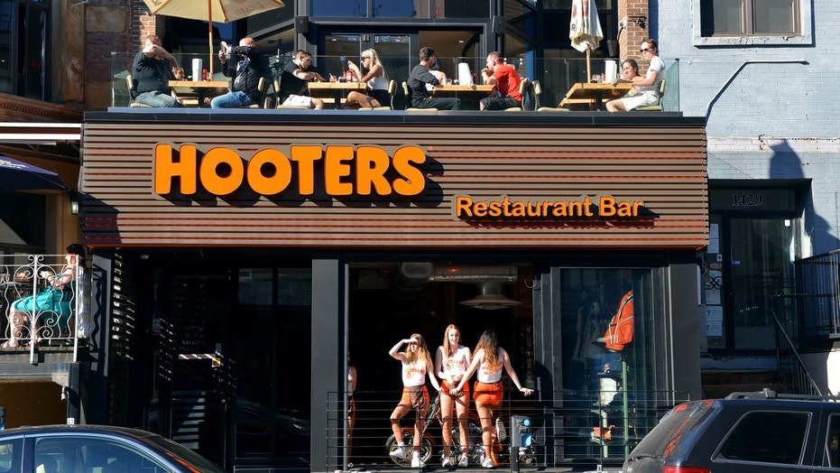 First responder allegedly spit on child, used racial slur at Hooters restaurant