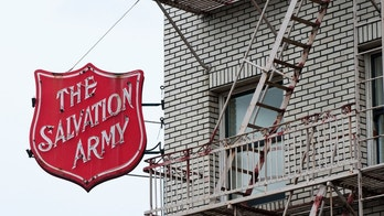 """Portland, OR, USA - April 3, 2012: Sign for the Salvation Army on a building in downtown. The Salvation Army is an international Christian organization which, according to its website, aims to preach the gospel of Jesus Christ and to meet human needs in His name without discrimination."""