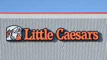 """""""Rochester Hills, Michigan, USA - January 10, 2012: The Little Caesars pizza restaurant located on Rochester Road in Rochester Hills, Michigan. Little Caesars is a chain of pizzerias and was founded in 1959 by Mike Illitch in Garden City, Michigan and has grown to thousands of locations worldwide."""""""