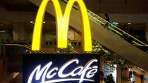 A McDonald's McCafe signage is pictured at Singapore's Changi Airport September 28, 2017. REUTERS/Edgar Su - RC1C39EA98D0