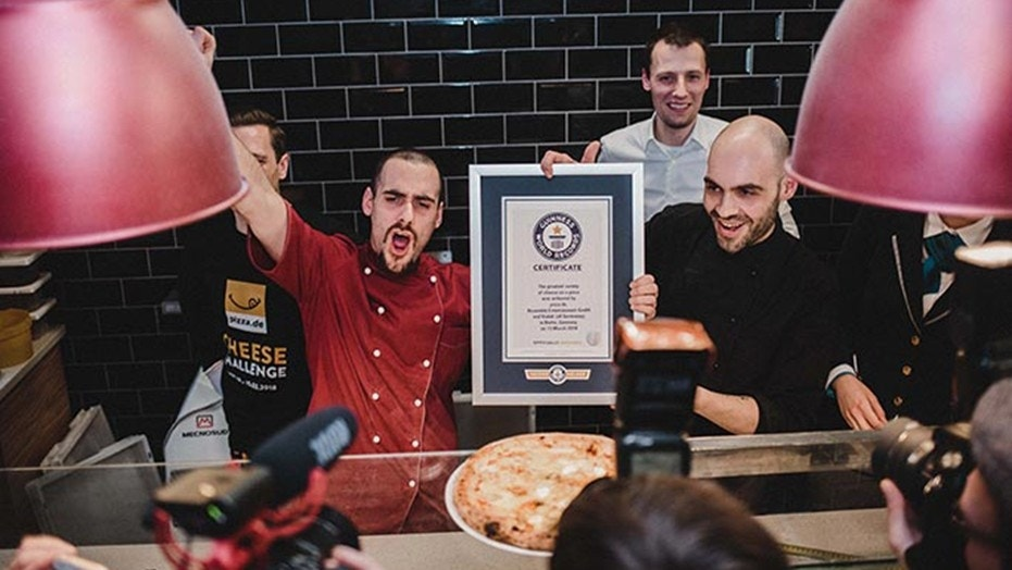 An American chef has crafted a record-breaking pizza by using 111 different types of cheese.
