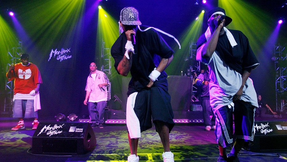 Method Man (C) and Streetlife (R) of rap band Wu-Tang Clan perform at the Montreux Jazz Festival in 2007.