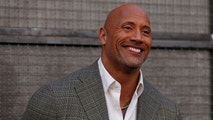 """Cast member Dwayne Johnson poses at the premiere for the movie """"Rampage"""" in Los Angeles, California, U.S., April 4, 2018. REUTERS/Mario Anzuoni - RC1D361EE270"""