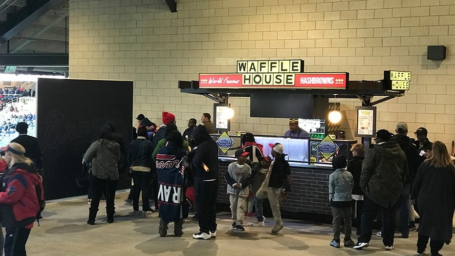 A newly-opened Waffle House stand at SunTrust Park in Atlanta, Georgia for the first time offers beer to fans of the famed restaurant chain.
