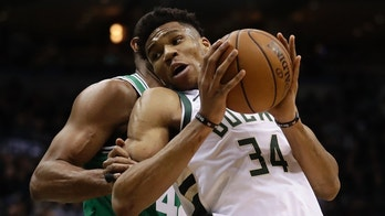Milwaukee Bucks' Giannis Antetokounmpo tries to drive past Boston Celtics' Al Horford during the first half of Game 3 of an NBA basketball first-round playoff series Friday, April 20, 2018, in Milwaukee. (AP Photo/Morry Gash)