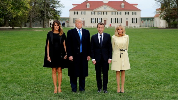 U.S. President Donald Trump and first lady Melania Trump and French President Emmanuel Macron and Brigitte Macron have their picture taken on a visit to the estate of the first U.S. President George Washington in Mount Vernon, Virginia outside Washington, U.S., April 23, 2018. REUTERS/Jonathan Ernst - RC126C16DC10