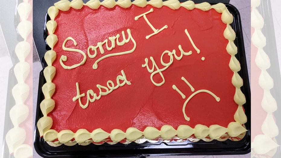 A police officer gave a firefighter a funny apology cake after a work mishap.