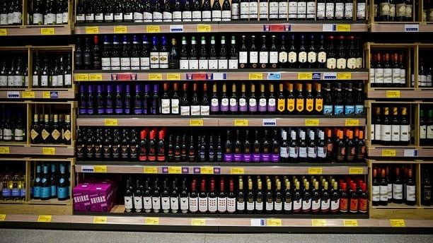 Bottles of wine are displayed on a shelf in an Aldi store in London, Britain February 15, 2018. REUTERS/Peter Summers - RC1F86F9EC20