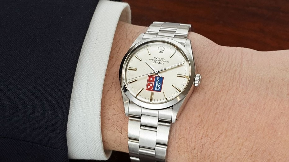 "A rare Domino's and Rolex ""double logo"" watch is going up for auction."