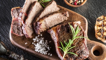Steak Ribeye with spices on the wooden tray.