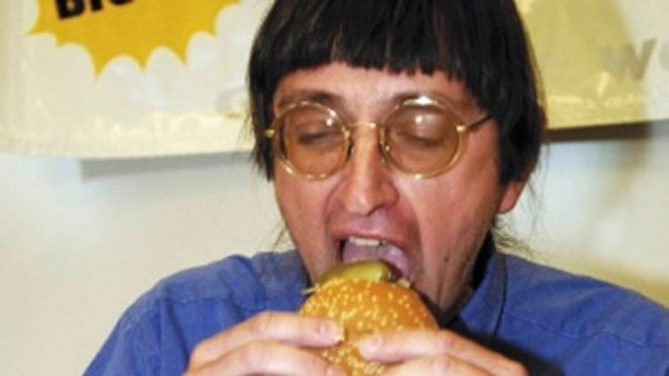 Don Gorske bites into the 18,000th Big Mac he has eaten in this Tuesday, Nov. 6, 2001 file photo at Fond du lac High School, in Fond du Lac, Wis.  The Fond du Lac man said he hit the 23,000 milestone in August 2008, continuing a culinary obsession that began May 17, 1972, and is fed by his obsessive-compulsive disorder. (AP/The Reporter)