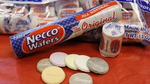 FILE - In this Oct. 14, 2009 file photo, Necco Wafers are displayed in Boston. Four bidders are vying to buy New England Confectionery Company, of Revere, Mass., the bankrupt manufacturer of Necco Wafers, Sweethearts and other iconic candies. A bankruptcy auction is scheduled for Wednesday, May 23, 2018. Necco said in March is will close and lay off hundreds of workers if a buyer isn't found. The company traces its roots to 1847 and calls itself the nation's oldest continuously operating candy company. (AP Photo/Charles Krupa, File)