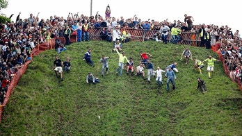 Cheese Rolling - Cheese Rolling  - Cooper's Hill, Gloucestershire - 25/5/09 A general view of the action Mandatory Credit: Action Images / Steven Paston Livepic - MT1ACI6005103