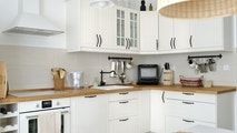 Interior shot from a white Scandinavian style kitchen in an apartment.