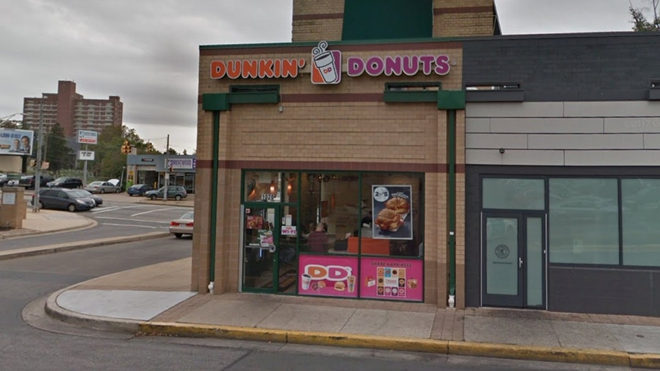 A Dunkin' Donuts in Baltimore is facing backlash over a sign posted in the store asking customers to report employees not speaking English.