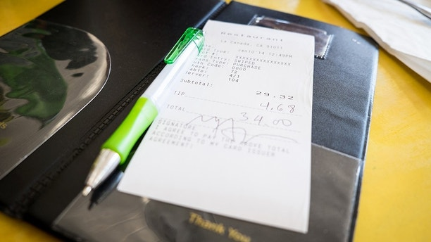 Credit card bill and pen in a restaurant