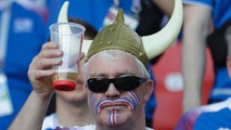 An Iceland fan toasts with a beer prior to the group D match between Argentina and Iceland at the 2018 soccer World Cup in the Spartak Stadium in Moscow, Russia, Saturday, June 16, 2018. (AP Photo/Matthias Schrader)