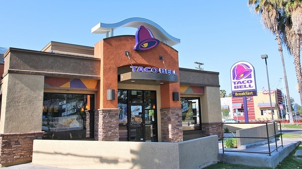Fresno, United States - April 12, 2014: Taco Bell restaurant in Fresno, California. Taco Bell has 6,446 restaurants and serves more than 2 billion customers yearly.