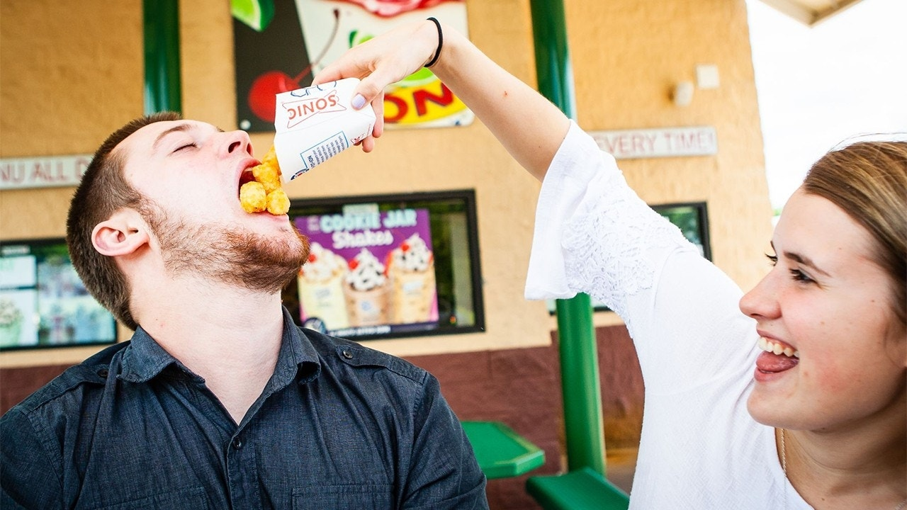 Couple who met at Sonic, bonded over tater tots, take engagement photos at fast-food chain