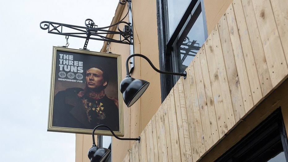 A Nicolas Cage-obsessed pub in England gave the actor a permanent home on their sign.
