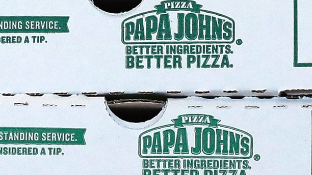 FILE- This Dec. 21, 2017, file photo shows pizza boxes stacked at a Papa John's pizza store in Quincy, Mass. Papa John's plans to pull founder John Schnatter's image from marketing materials after reports he used a racial slur. Schnatter apologized Wednesday, July 11, 2018, and said he would resign as chairman after Forbes reported that he used the slur during a media training session. Schnatter had stepped down as CEO last year after criticizing NFL protests. (AP Photo/Charles Krupa, File)