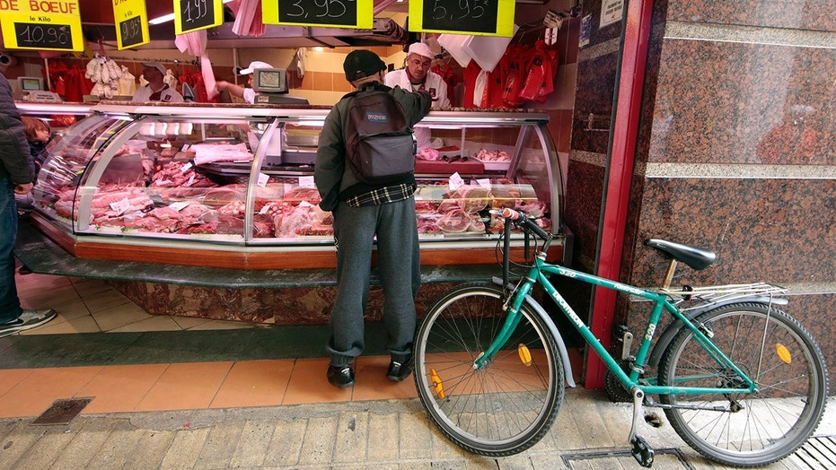 A customer is seen at the Boucherie St Francois butcher shop in the old city of Nice, France.