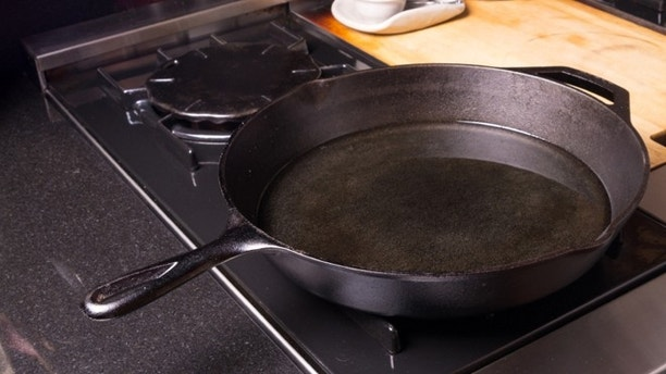 A black cast iron skillet or frying pan on the stove