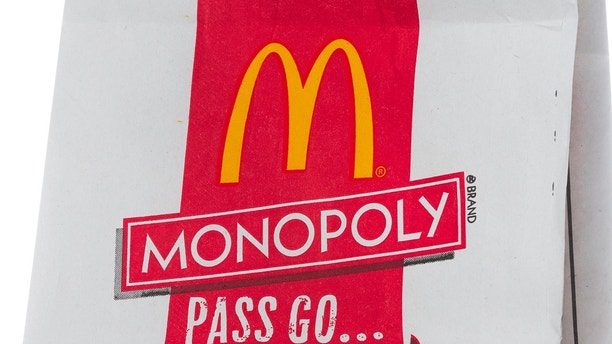 """""""Miami, USA - October 08, 2012: McDonalds paper bag for take out with Monopoly promo. McDonald's Corporation is the world's largest fast food chain."""""""