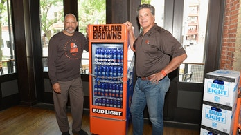 "CLEVELAND, OH - AUGUST 14:  On Tuesday, August 14, 2018, Bud Light and the Cleveland Browns unveiled the ""Browns Victory Fridge"" in Cleveland with the help of Browns legends Felix Wright and Frank Stams on August 14, 2018 in Cleveland, Ohio. This smart-technology fridge will automatically unlock after the Browns secure their first regular season win.  (Photo by Duane Prokop/Getty Images for Bud Light)"