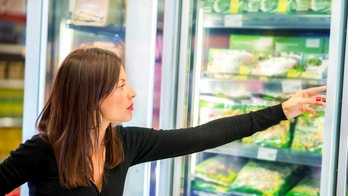 grocery shopping woman frozen istock