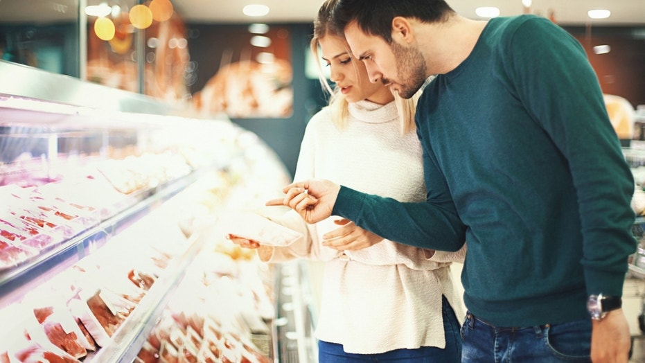 couple shopping for meat