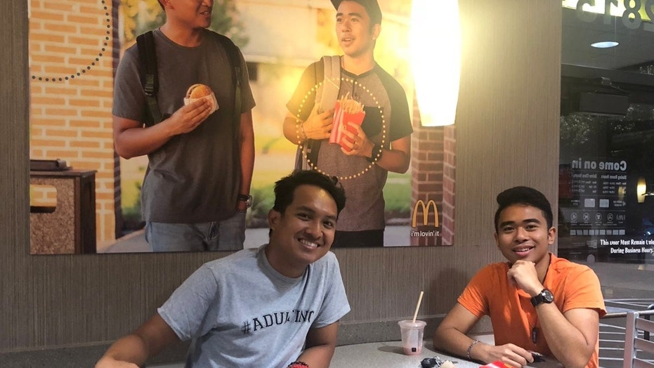 Two customers at a McDonald's in Pearland, Texas, created and hung a fake ad — picturing themselves — at the restaurant.
