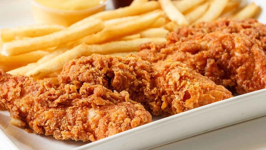 A woman was caught on camera dipping her chicken finger in soda.