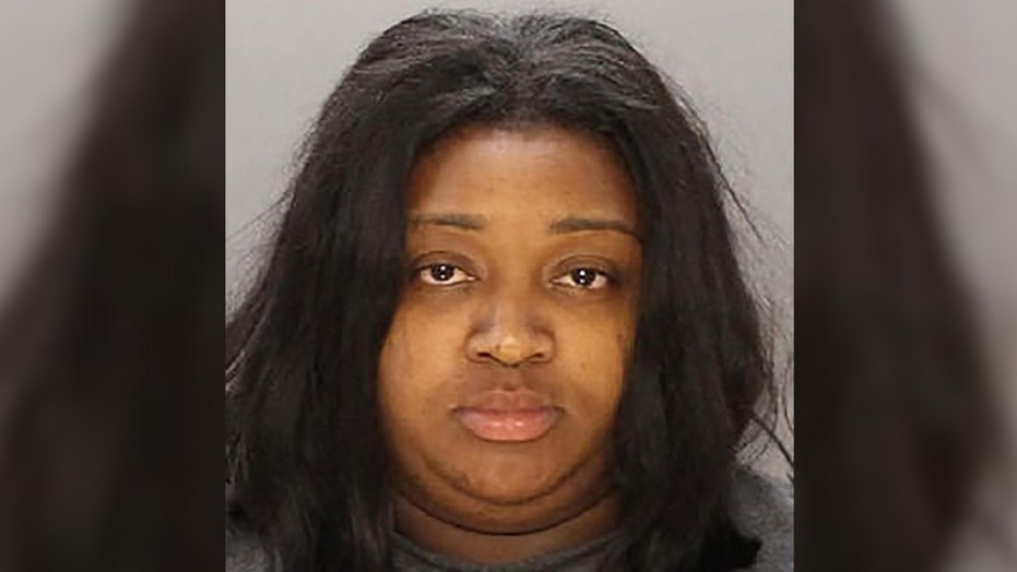 Twenty-eight-year-old Latifah Linder was arrested for allegedly throwing grease at three customers.