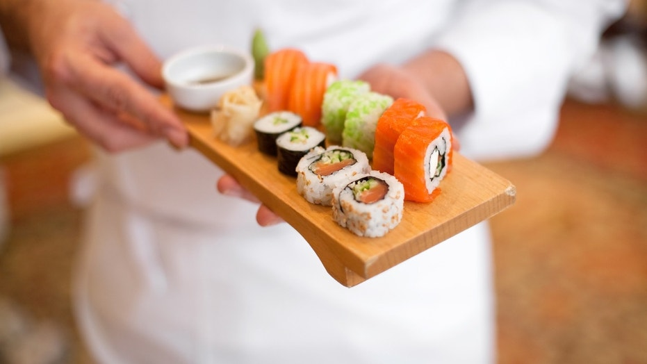 The triathlete ate nearly 100 plates of sushi.