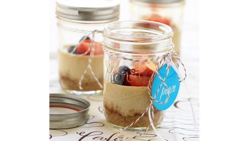 Personal cheesecakes in decorated mason jars.