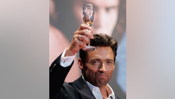 "Actor Hugh Jackman with a glass of champagne gives a toasts to fans at a red carpet event for the Japan premiere of ""X-men Origins: Wolverine"" in Tokyo September 3, 2009.    REUTERS/Michael Caronna (JAPAN SOCIETY ENTERTAINMENT) - GM1E5931IJ101"