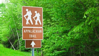 Appalachian Trail hiking sign with trees in background