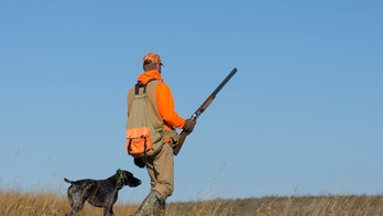 Out Pheasant Hunting on the prairie with his dog